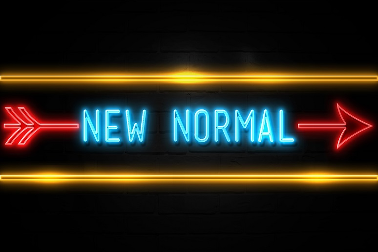 New Normal - fluorescent Neon Sign on brickwall Front view